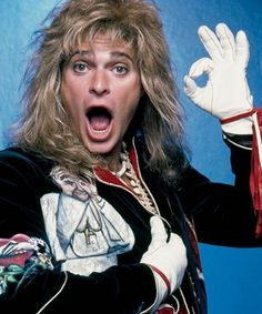 David Lee Roth singer of Van Halen doing the 666 sign, and wearing a t-shirt with the image of the pope doing the same thing. He also wears red wistband probably showing his belief in gnosticism as an obvious satanist. David Lee Roth, Alina Starkov, Illuminati Symbols, Alex Lifeson, Leigh Bardugo, Eddie Van Halen, Barry Gibb, 80s Rock, Signs
