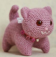 Free knitting pattern for Knitted Kitty - A folded knitted square is all you need to make the cat body in Lillian's ingenious pattern. The head and tail are knitted flat and seamed.