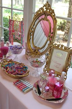 accessories table Mirror and books and bracelets and necklaces as party favors
