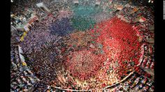 2014: The year in pictures - CNN.com. October 5: People form a human tower called a castell during a biannual competition in Tarragona, Spain. The formation of human towers is a tradition in Spain's Catalonia region.