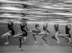 Picture of a team of synchronized swimmers underwater