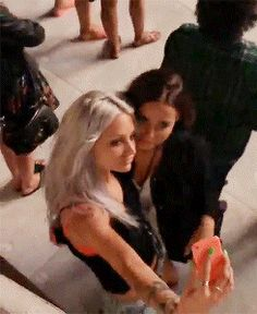 lou and Sophia taking a selfie... and then Eleanor's like let me phootbomb