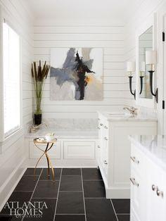 Modern Farmhouse-Builders Floor Covering & Tile installed the sleek Black Blizzard slate flooring in the otherwise neutral master bathroom.