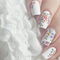 Dainty white nails…