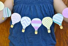 DIY Hot Air Balloon Garland - by Laura Russell of Make Life Lovely http://www.makelifelovely.com/2014/07/diy-hot-air-balloon-garland.html