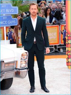 May 2016: Ryan Gosling steps out for The Nice Guys UK premiere in London, England. Gosling embraces a pop of color in a green Gucci Made to Measure Heritage suit in corduroy.