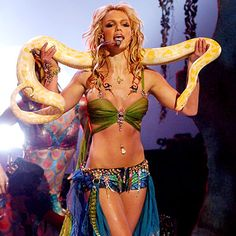 Britney Spears at the height of her career in 2001. Sizzling hot in her VERY famous and unforgettable VMA performance. Oh I still love me some Britney. :)