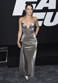 "Actress Michelle Rodriguez was stunning at the premiere of ""The Fate of the Furious"" in a shimmering hip-hugging silver gown and matching heels."