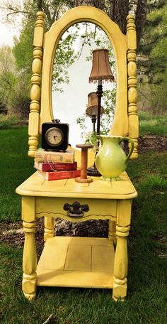 My renovation project. Yellow antique mirror and matching end table for sale to the highest bidder. Also taking requests.