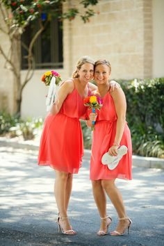 Fun and bright coral bridesmaid dresses | From Kristen and Niko's dreamy Florida beach wedding: http://www.xaazablog.com/tropical-colors-beach-wedding-kristen-niko/ Photography: Binaryflips Photography #weddingdecor #centerpieces #weddingflowers