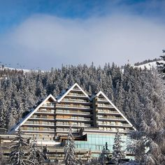 Many hoteliers, faced with the task of designing a hotel in an Alpine setting as awe-inspiring as Switzerland's Crans-Montana, would opt for something safe and unremarkable, and convince themselves they're letting the landscape take center stage. Crans Ambassador, on the other hand, takes a more active approach; this building aims to complement the majesty of the Alps, not cower before it, and thanks to its rakish angles and its monumental modern spaces, you'd have to judge it a success. Montana, Modern Spaces, Center Stage, Switzerland, Skiing, Cabin, Landscape, Architecture, House Styles