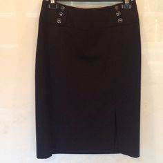 White House Black Market Black Skirt with Slit! My absolute favorite work skirt! Wish I could still fit in it! WHBM black skirt with cute button detail at waist and great slit at leg; hidden side zip. Fab with a white button up! Tiniest pick in fabric at waist as seen in 3rd photo. White House Black Market Skirts