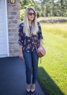 A grey floral top is paired with Chambray Banana Republic Sloan pants for an easy work outfit that is perfect for the summer to fall transition.