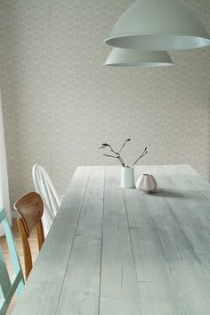 *white wash table top.*different coloured chairs. *simplicity