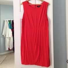 Fire orange/red knit dress with back zipper. Fire orange dress with back zipper detail. Pleated details on front. Faux wrap around style. Worn only once or twice. XXL. Great vibrant, flattering color. Mossimo Supply Co. Dresses