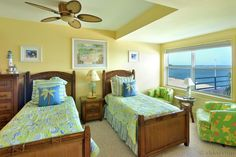 This beautifully decorated bedroom provides two twin size beds, a twin set of green tropical print barrel chairs, a great view of the water. Private Key West Sunset | 3 Bedroom Nightly Vacation Rental