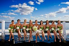Beautiful day at the lake with bride and bridesmaids sitting on the dock | Matt Mason Photography | Lake Geneva, WI