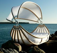 This cradle-shaped bed is aptly titled 'Float'. The impressive design of it is from Okooko, designed by New Zealand designer—David Trubridge...