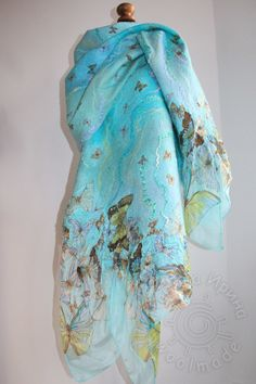 Felted scarf Mojito Butterfly Scarf shimmers from pale sky blue color,to mint color, sometimes slightly brighter greenish and bluish turquoise. And