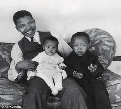 Kumalo, Alf. Nelson Mandela sitting with two of his children