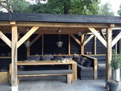 contemporary dining pergola in charcoal grey and pale natural wood