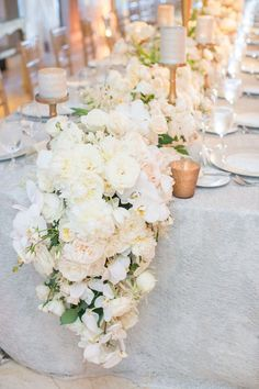 White Cascading Floral Runner on Grey Linen | Photo: Thisbe Grace Photography.