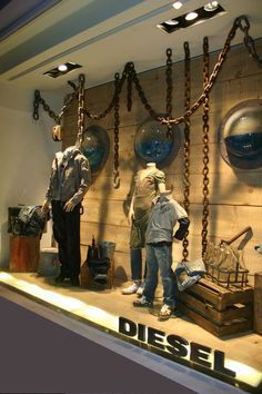 Window Visual Merchandising | VM | Window Display | Chains hanging from ceiling.