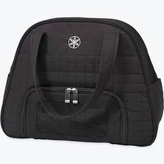 A cute & compact carry-all for your work out essentials. Don't be stuck at the gym without what you need, the eco-chic Gaiam Everything Fits Gym Bag keeps your essentials all in one place. Features an