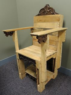 Pallet Wood Chair I'd put some straps on the arms, put a dummy in it with a collender on it's head and use it as an ELECTRIC CHAIR FOR HALLOWEEN!