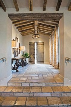 Mediterranean Entryway with Exposed beam, Restoration Hardware Acanthus Leaf Artifact Lamp, sandstone tile floors, Chandelier