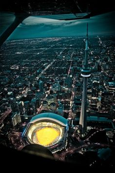 Aerial view of the The Rogers Centre and the CN Tower, Toronto, Ontario, Canada Toronto Skyline, Toronto City, Art Toronto, Downtown Toronto, Ontario, British Columbia, Torre Cn, Places To Travel, Places To See