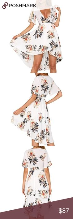 Floral High Low Empire Waist Wrap Dress XS-XL Pretty white floral print, leg flattering high low hem, romantic wrap style with a deep V neck line and short sleeves. This feminine, versatile dress is great for everything from a day at the beach to date night.   ❌ Sorry, no trades.   fairlygirly fairlygirly Dresses High Low