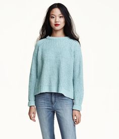 Rib-knit sweater in soft, slightly fluffy chenille with long raglan sleeves. Wide ribbing at neckline.