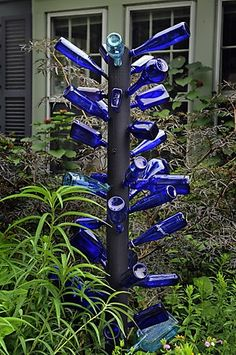 Image detail for -... Bell's garden displays art, including this bottle tree of blue glass garden art www.washingtonpos...