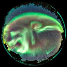Using a fisheye lens, photographer O Chul Kwon captured a 180-degree view of the sky as curtains of northern lights danced in the sky above Enodah Lodge in Yellowknife, Canada. Astrophotographer O Chul, 36, born in Korea, said: