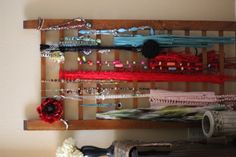jewelry scarf display from an antique crib rail