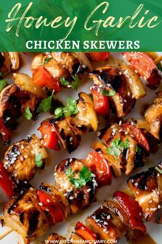 Honey Garlic Chicken Skewers - Tender pieces of marinated chicken cooked on a BBQ or griddle for a sweet and smoky flavour. The best chicken kebabs made at home! #chickenkebab #chickenskewers