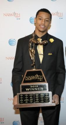Trey Burke of the University of Michigan and his 2013 Naismith Trophy presented by AT