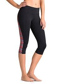 Moisture-wicking, knee/capri length pants are recommended over a bathing suit for the caving adventure