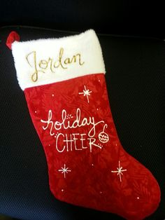 Custom Stockings! Fun and simple! Buy a stocking from the dollar store and decorate with your favorite holiday greeting using puffy paint. #DIY #Craft #Christmas #Stockings
