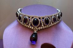 Contemporary Faberge diamond choker, featuring dark eggplant cabochon amethysts, a decent central amethyst also available the complementary set of ring and earrings