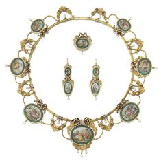 Gold enamel and micromosaic demi-parure, Mid 19th Century Comprising: a necklace set with seven graduated micromosaic plaques, depicting rural genre scenes and arrangements of flowers inset into malachite plaques, decorated with black and white enamel ribbons and floral swags, further accented with seed pearl drops, together with a pair of pendent earrings, hook fittings and a brooch en suite, French assay marks.