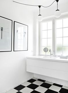 White bathrooms with b&w patterned floors