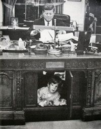 JFK and JFK, Jr.  A famous image of a  little boy under his father's desk.