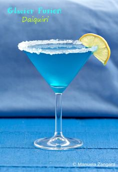 Glacier Fusion Daiquiri - an #apple based #Daiquiri with a hint of Blue #Curaçao that makes this drink a beautiful turquoise, just like the ice on a glacier!