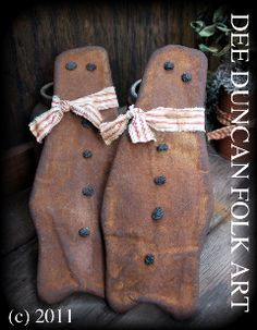 """Gingerbreads by Dee Duncan Folkart.  Make something similar using """"fake gingerbread"""" (the kind with glue/cinnamon and applesauce)!  This also reminds me that something cute and gingerbread-y could be made with brown paper bags...aged, etc."""
