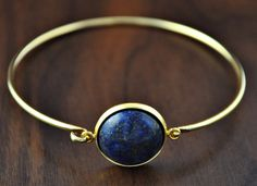 Gold plated bangle with precious stone(Lapis Lazuli) cabochon. Perfect as a unique gift to yourself or for someone special – a unique product by Ladysworld via en.DaWanda.com