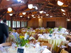 The reception decor exuded a relaxed, country feel with white pitchers ...