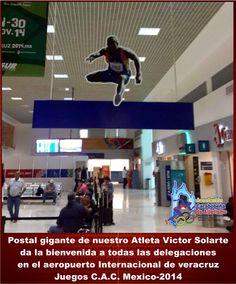 Victor-Solarte. Postal gigante de nuestro Atleta Victor Solarte da la bienvenida a todas las delegaciones en el aeropuerto Internacional de veracruz Juegos C.A.C. Mexico-2014