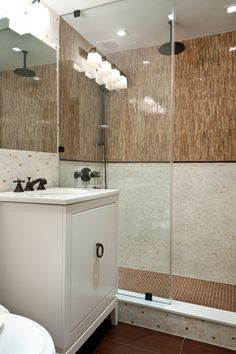 Artistic Tile   This New York City bathroom features two patterns from our Jazz Glass collection; Coltrane Creme in the Miles Modular pattern and Ella Light Brown Satchmo Sticks.